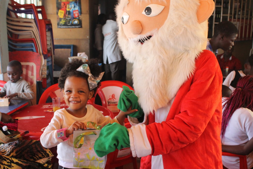 Lil'missbelle getting her gift from Santa