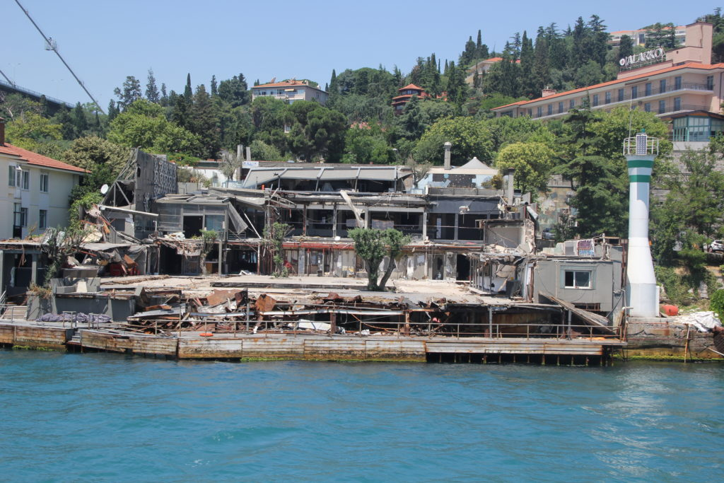 A ruined hotel along the coastline